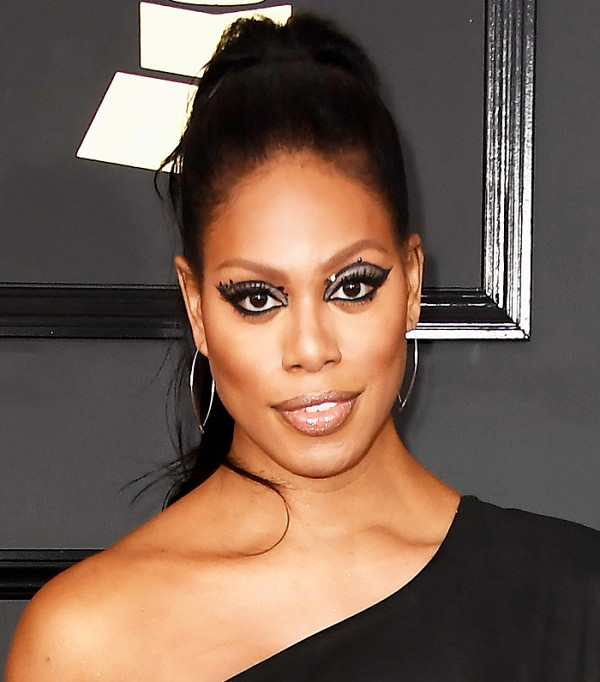 Laverne Cox's Slicked-back Chic High Ponytail Updo with Classic Nude Lip