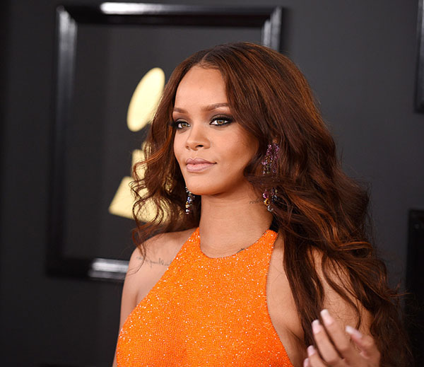 Rihanna's honey-kissed center-parted auburn waves