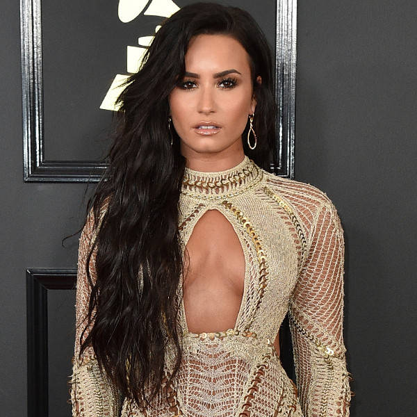 Demi Lovato's side part mermaid-like locks